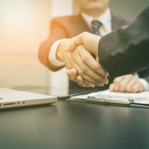 Business handshake and business people on deal concept