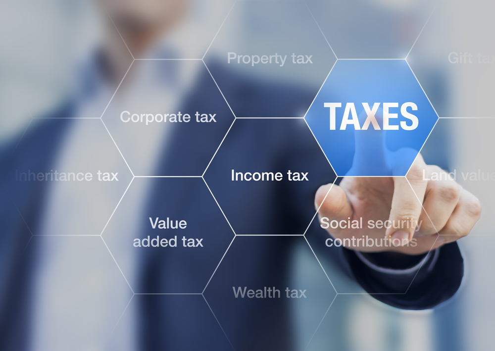 Businessman showing concept of taxes paid
