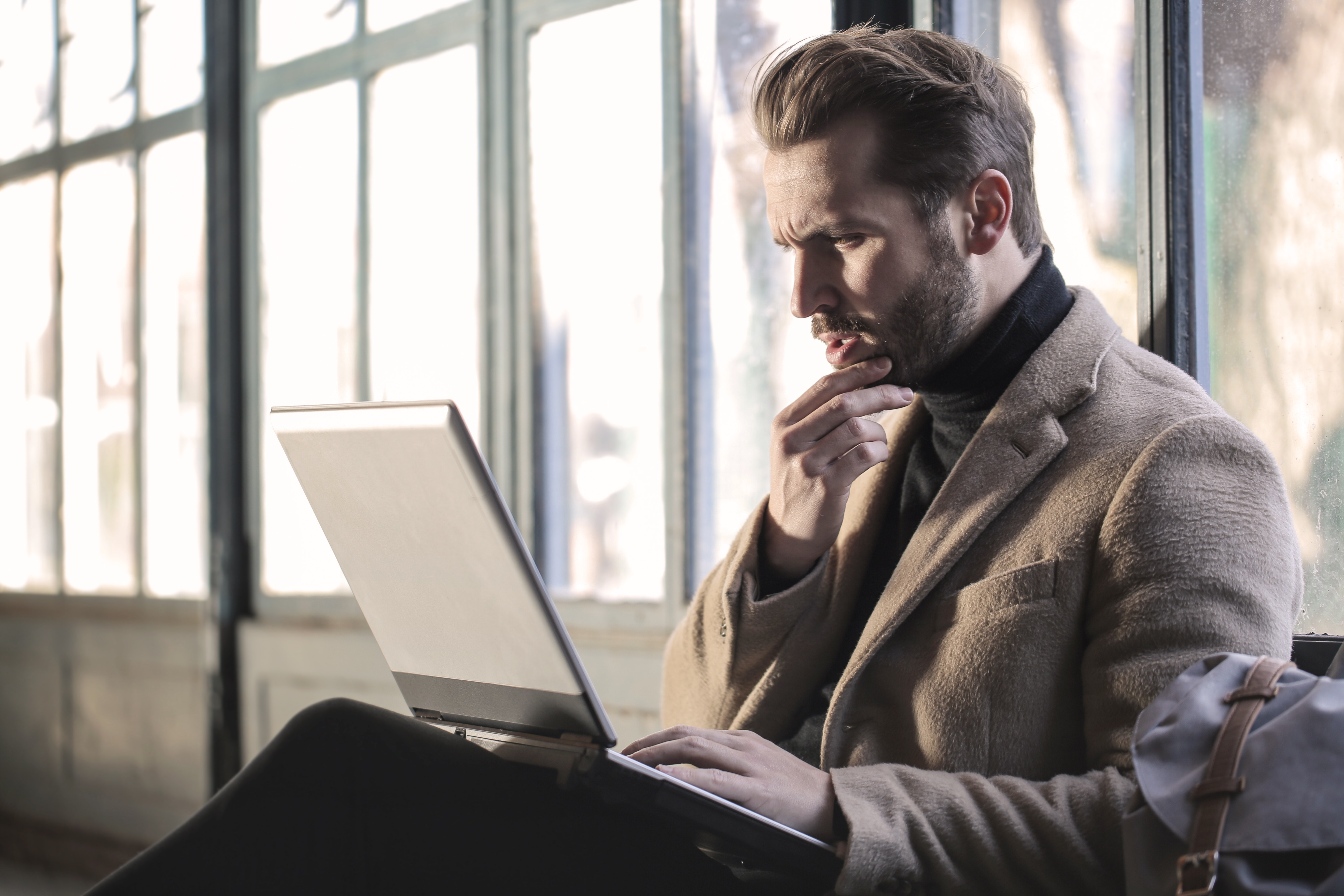 confused man on laptop