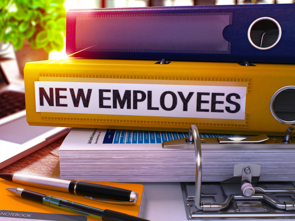 folder with new employees written on it
