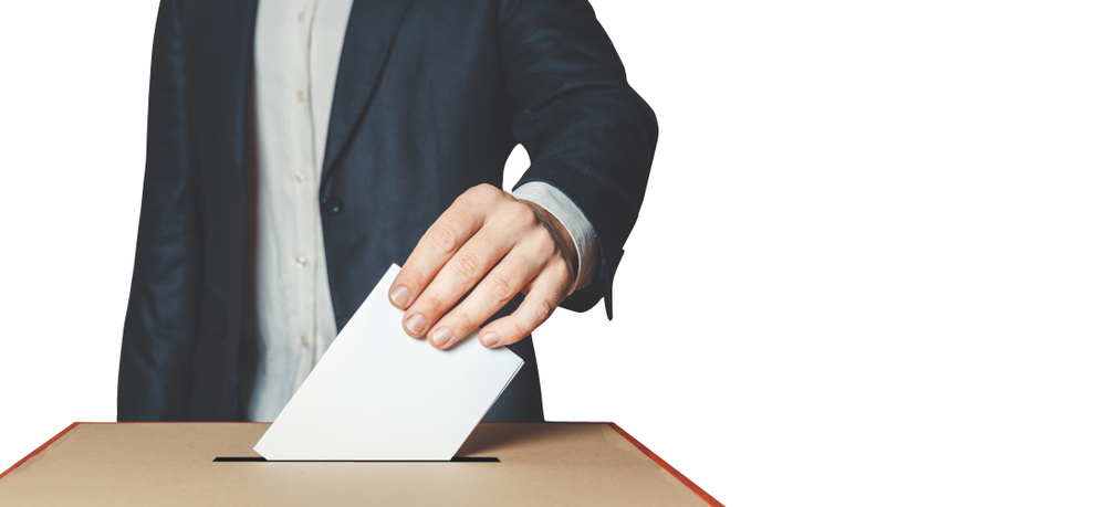 Man Voter Putting Ballot Into Voting box