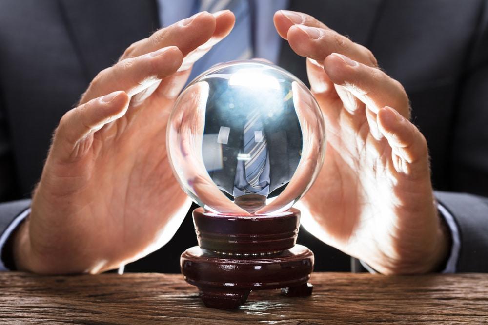 businessman prediction crystal ball