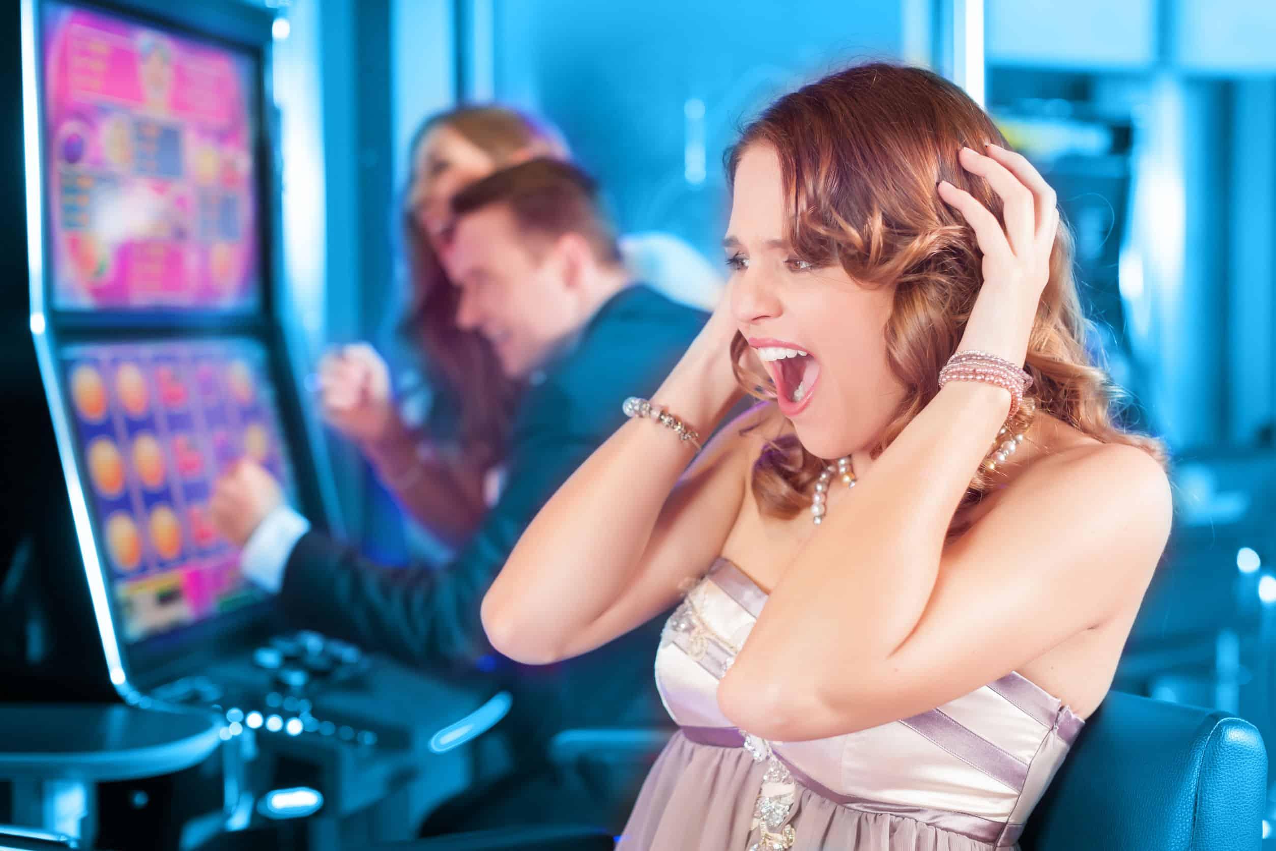 Friends gambling on slot machine