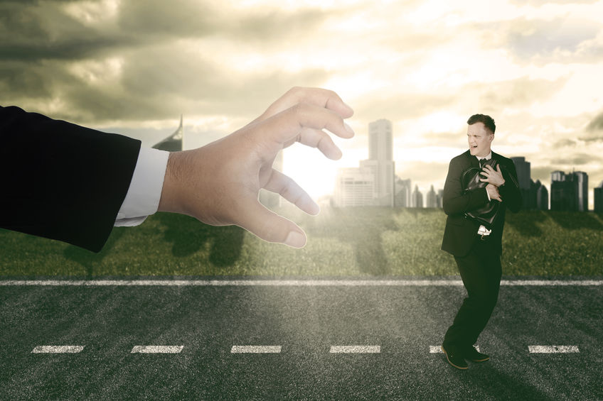 Businessman running scare being chased by a big hand