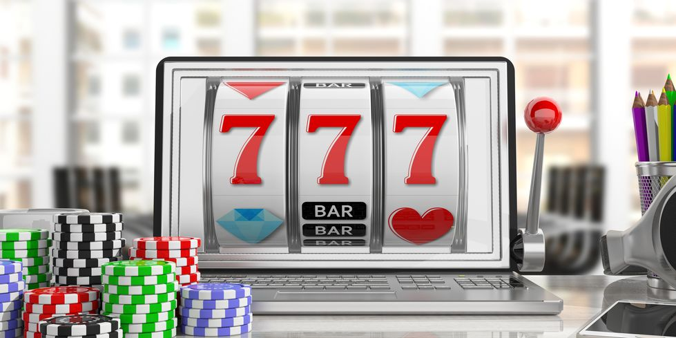 Slot machine on a laptop screen and poker chips
