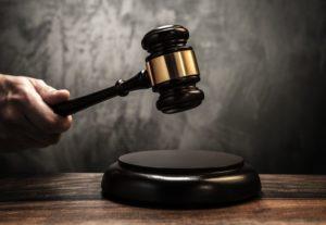Judge's holding wooden hammer