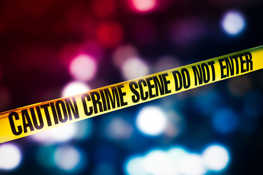 crime scene tape with red and blue lights on the background