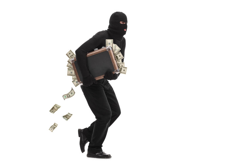 Burglar running with a bag full of money