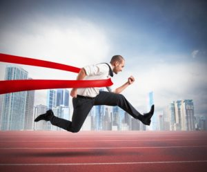 Successful businessman on the finishing line of a track
