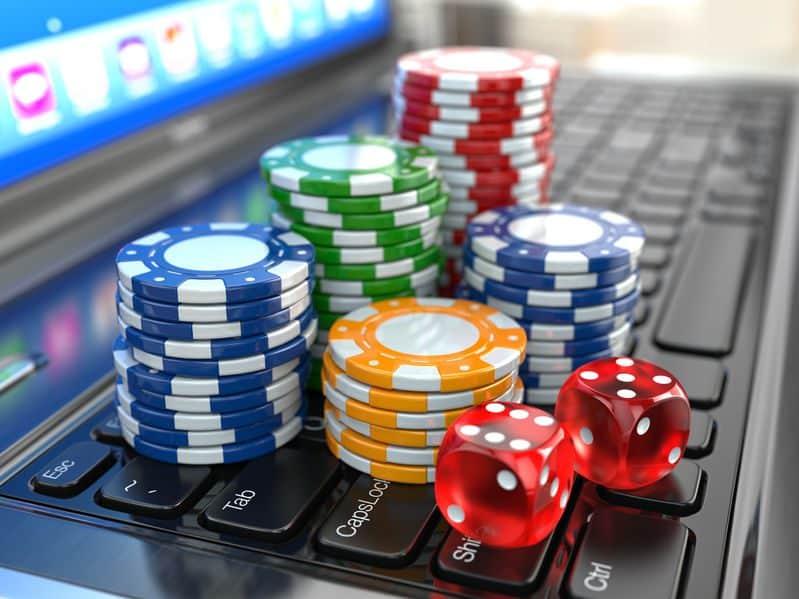 casino chips on laptop