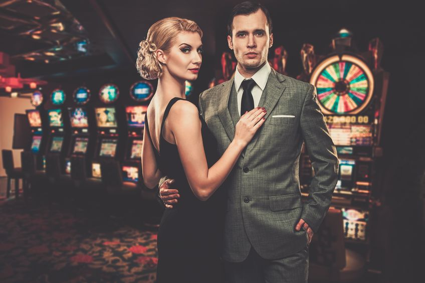 couple standing in front of slots