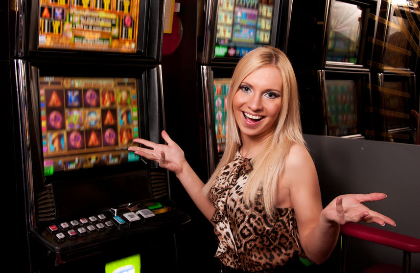 woman in front of slot machines